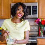 Tanya Harris in her kitchen with a measuring cup with a whisk